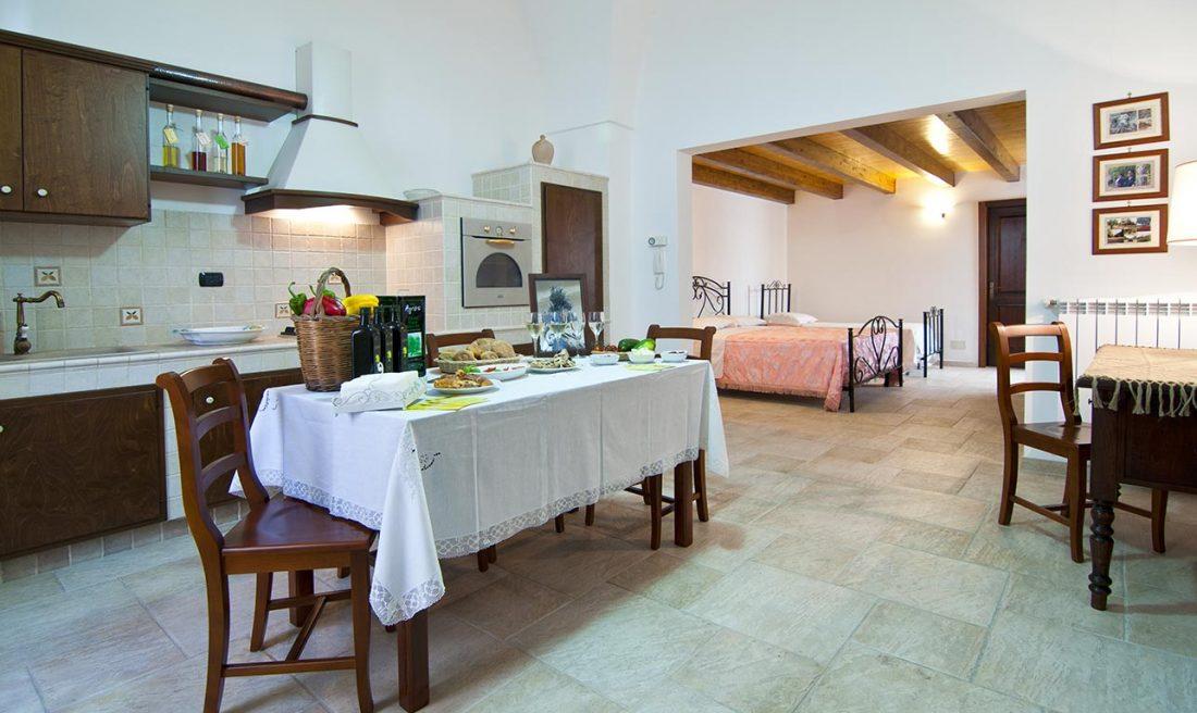 appartamento supersano rustico casa vacanze la scisa appartamenti nel salento cucina e altri posti letto
