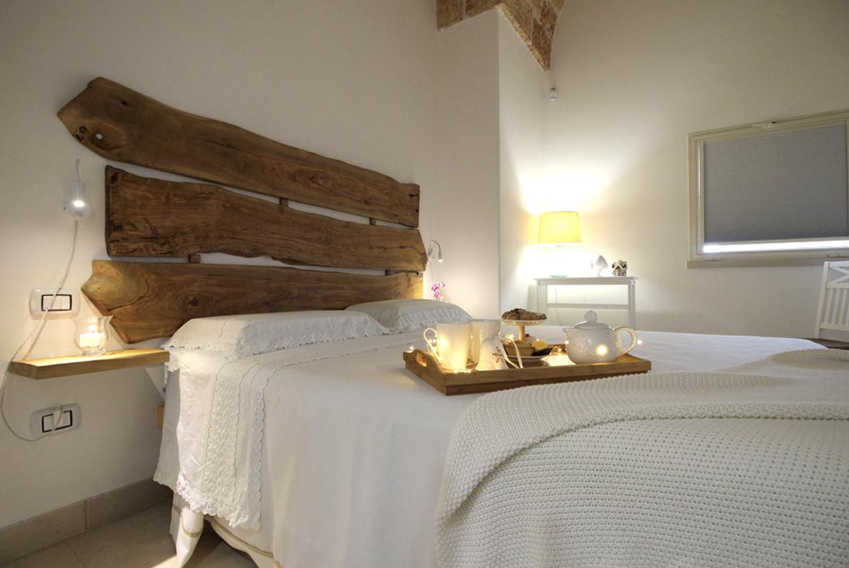 Home Holiday Salento appartamenti in affitto nel Salento camera da letto Belvedere Specchia